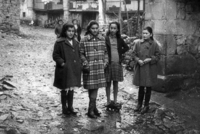 The Four Girls on a street in the village.